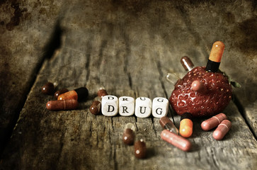 old shabby filthy Photo drug pill on wooden table concept addict