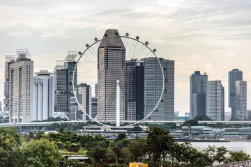 Singapore flyer with skyscrapers in background