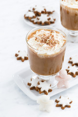 festive pumpkin latte and almond cookies on a white background