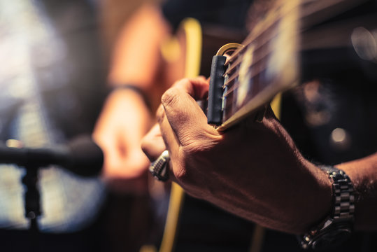 Acoustic guitarist in the studio vintage photograph