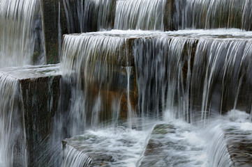 thresholds of artificial waterfall from stone blocks. closeup