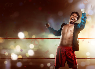 Asian boxer posing celebrate after victory