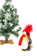 Penguin figurine with skis and christmas tree