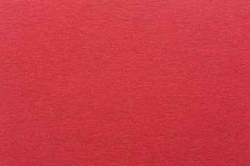 Red paper background with delicate pattern.