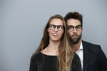 Couple pulling funny faces for camera