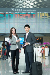 asian young beautiful girl and handsome man in airport