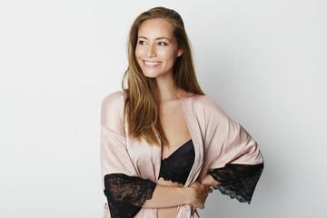Beauty in lace nightwear and bra, smiling