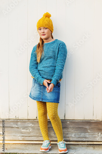 7ba7f7e41a1dd Outdoor fashion portrait of cute 9 year old little girl