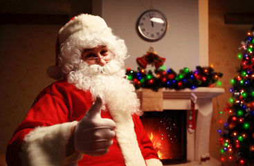 Santa Claus standing with thumbs up