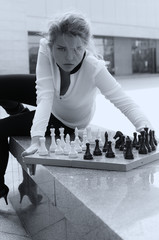 Girl aggressively playing chess
