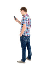 Back view of standing young men and using a mobile phone