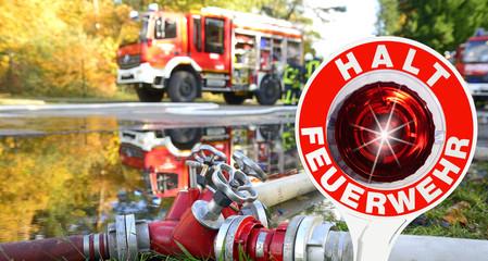 Feuerwehr Einsatz mit Haltekelle Bevölkerungsschutz