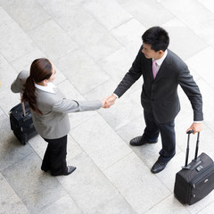 top view of woman is shaking hands with businessman