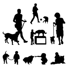 Man and Boy Walking and Playing with Dog Silhouette