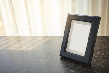 Blank Mock up Picture Frame Home interior morning light Shade window