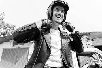 portrait of a smiling biker sitting on motorcycle, biker helmet,