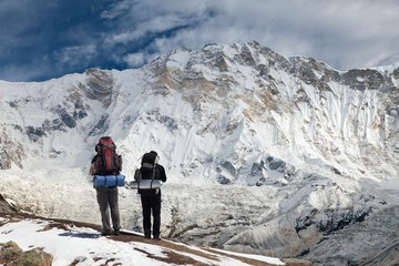 View of Mount Annapurna with two climbers