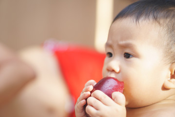 Asian baby and apple