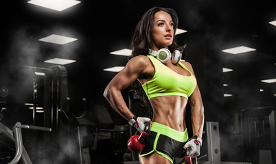 young woman is engaged in bodybuilding