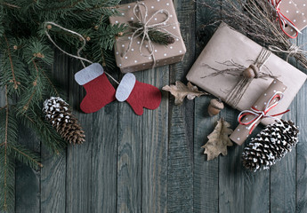 Christmas background with gift box, Santa Claus boots and scroll