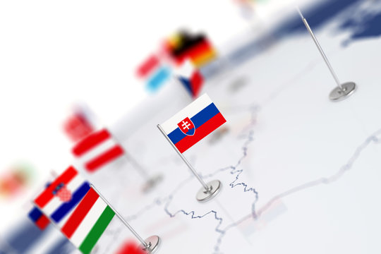 Slovakia flag in the focus. Europe map with countries flags