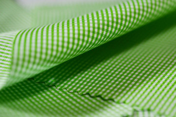 close up texture green and white scott pattern fabric of shirt