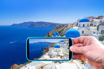 Making photos by smartphone of Santorini island