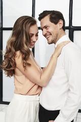 Romantic couple in smart fashion, smiling