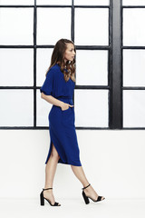Blue dress girl walking in studio