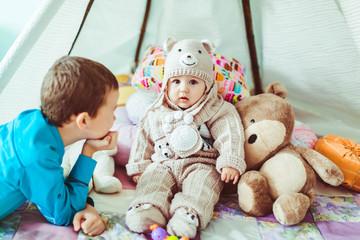 little boy admires his newborn brother