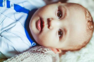 cute newborn baby looking at the camera