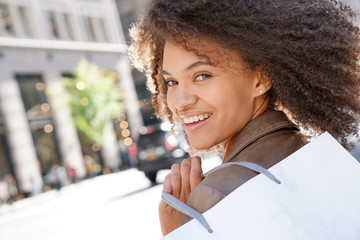 Cheerful girl doing shopping in New York City