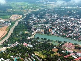 Aerial view over the town in Thailand. City skyline background.