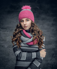 A woman in winter pink hat and scarf.