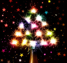 Christmas New Year's  tree form fireworks  sparks on hearts  dark background from the bottle chmpagne