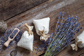 Bunch of lavender flowers and three sachets filled with lavender