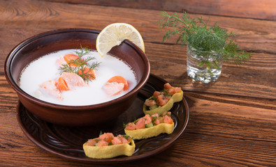 Fish soup with salmon, cream, vegetables and herbs