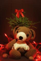 Christmas winter card with teddy bear and Christmas tree with lights