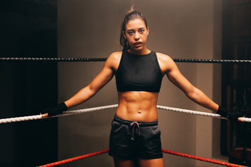 Fit young woman boxer with toned abdominal muscles