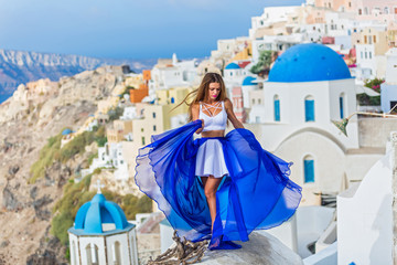 Woman on the roofs of Santorini