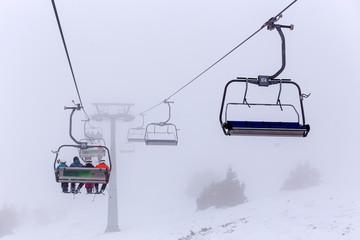ski lift chairs in fog on ski resort Kopaonik, Serbia