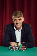 Young handsome guy with poker chips