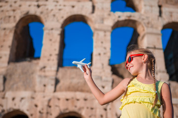 Tourist girl with small toy model airplane background Colosseum in Rome, Italy Fototapete