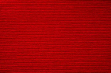 Red fabric background texture closeup.