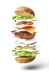 Fototapeta Delicious hamburger with flying ingredients obraz