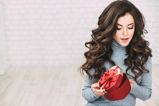 Beautiful woman open red gift shape heart.