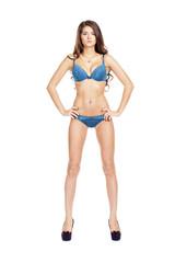 Full length portrait of young girl wearing blue bikini