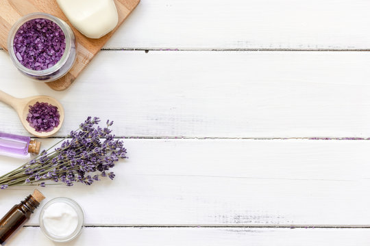 natural creams with lavender flowers on wooden table