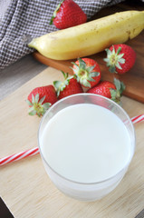Top view of Glass of Milk with Fresh Fruits