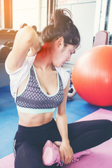 Healthy woman Injury from exercise in the gym, injured her neck.